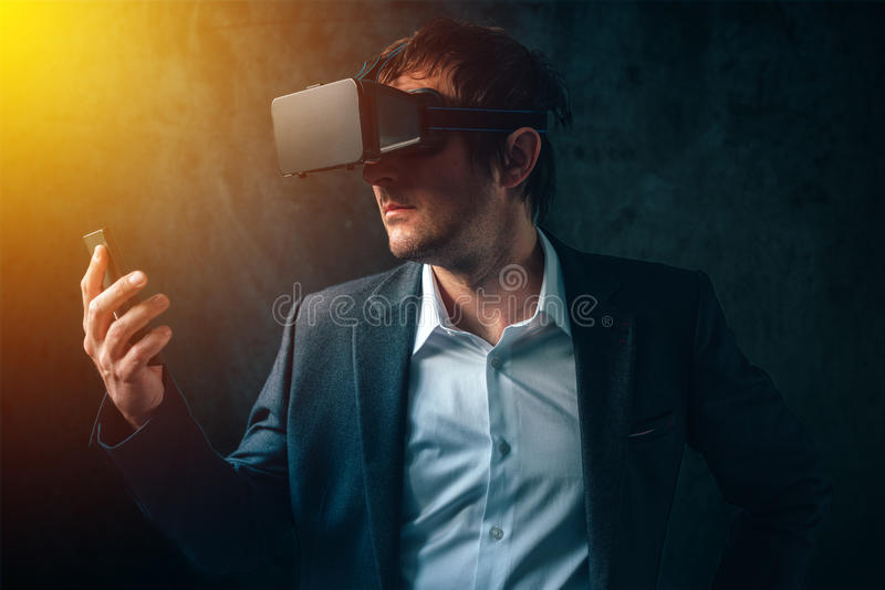Futuristic technology in modern business, businessman with VR he royalty free stock image