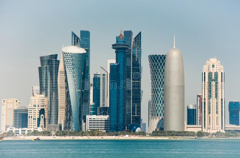 Futuristic urban skyline of Doha, is a city on the coast of the Persian Gulf. Futuristic urban skyline of Doha, a city on the coast of the Persian Gulf, the stock image