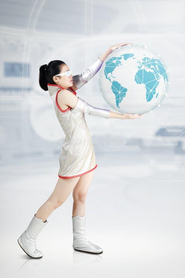 Futuristic woman holding a virtual globe stock images