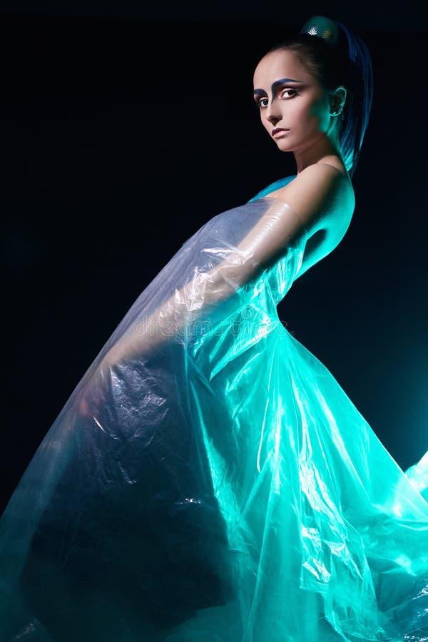 Futuristische samenstellingsvrouw in plastiek royalty-vrije stock afbeeldingen