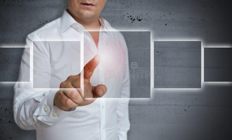 Futuristische touchscreen wordt in werking gesteld door mensenconcept royalty-vrije stock afbeeldingen