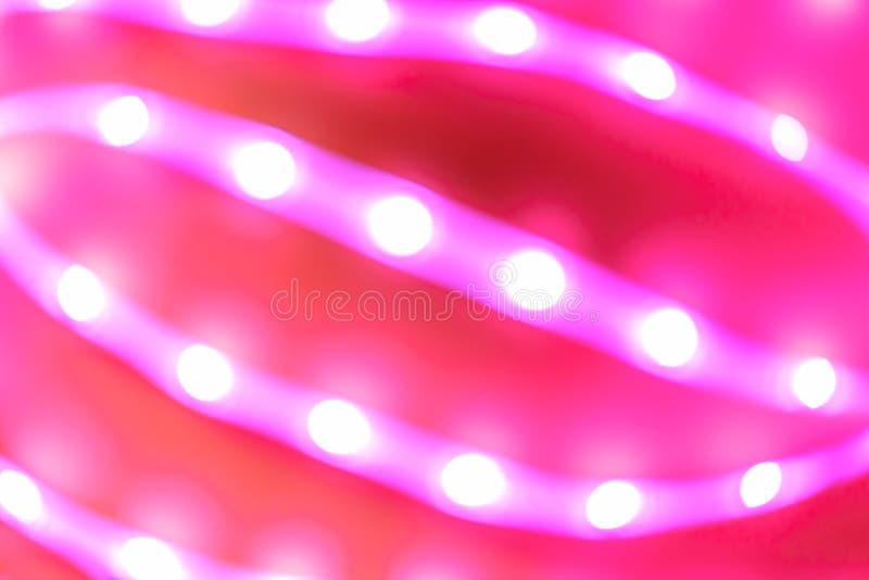 Futuristisk suddig neonnedgång i röd och rosa färg royaltyfria foton