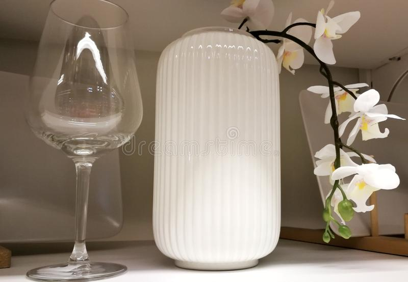 fuzhin for wine with an orchid in a white vase, option of a decor of the house royalty free stock images