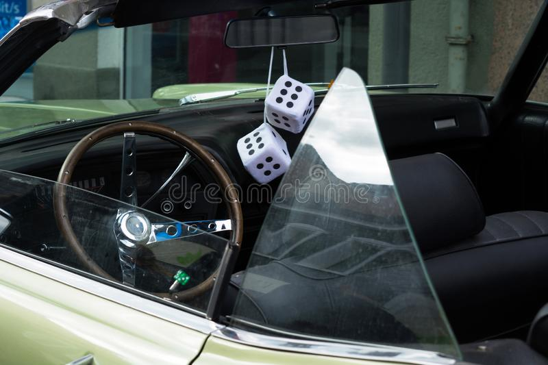 Fuzzy Dice on the rearview mirror stock image