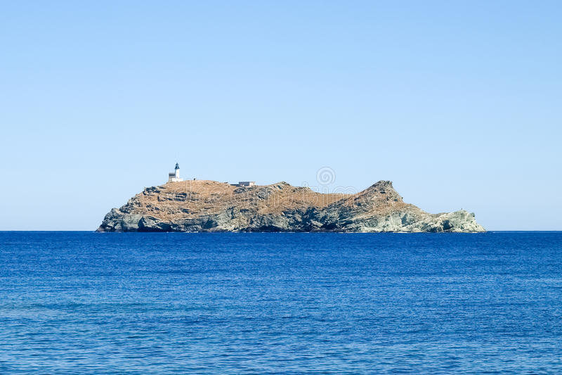Fyr av ön Giraglia arkivfoton