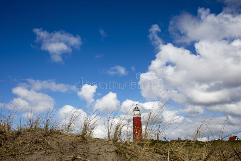 Fyr av Texel holländarehimmel royaltyfri bild
