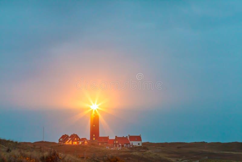 Fyr på den holländska ön av Texel arkivfoton