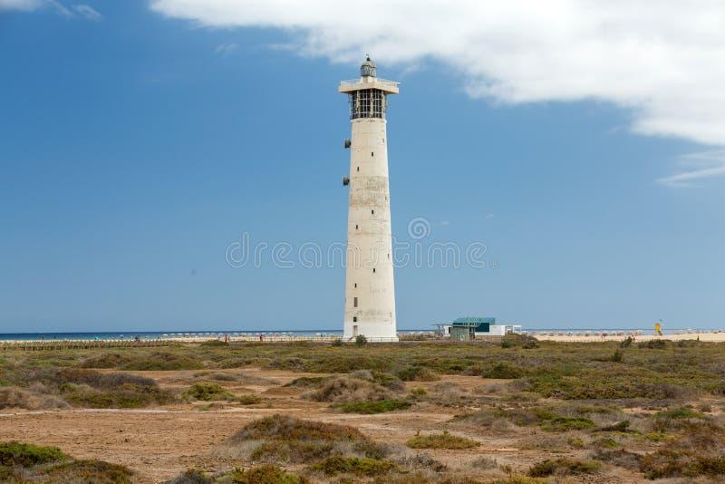 Fyr på Playa del Matorral, Jandia Morro Jable, Fuerteventura royaltyfria bilder