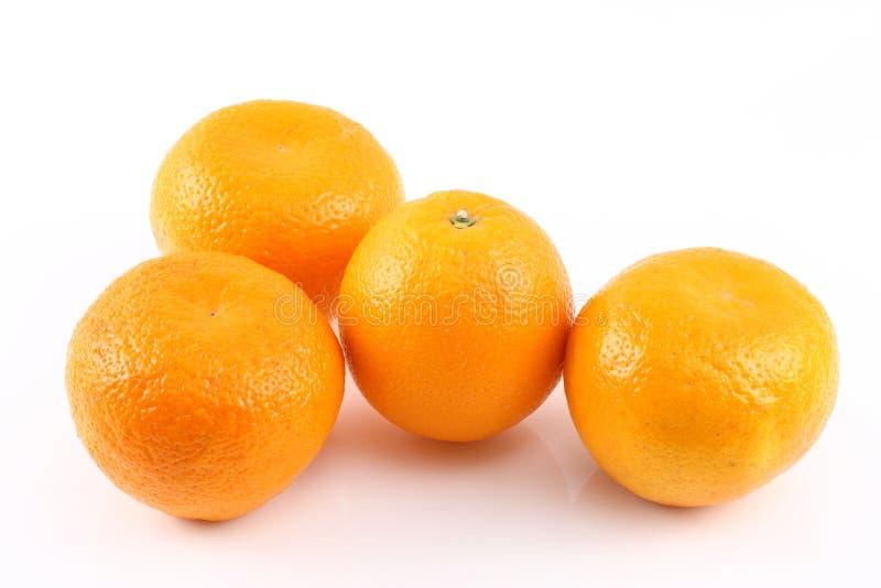 fyra apelsiner arkivfoto