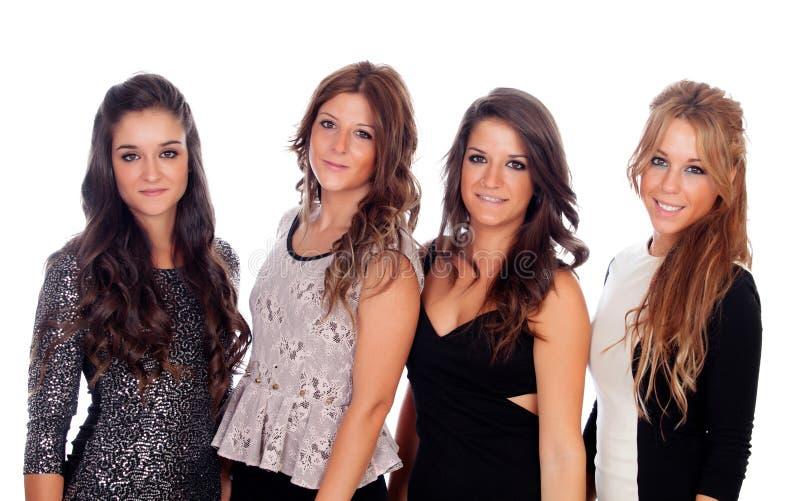 Fyra bra vänner med eleganta klänningar royaltyfria foton