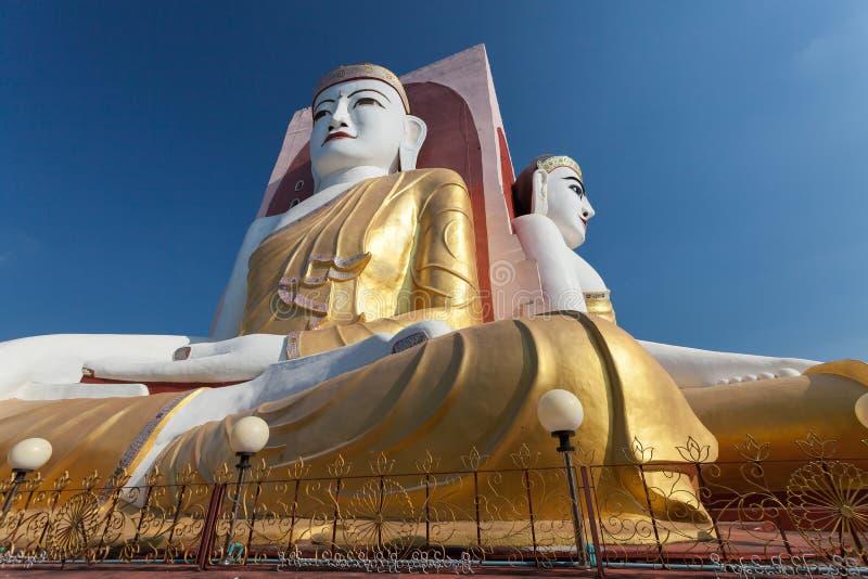 Fyra framsidor av Buddha på den Kyaikpun Buddha fotografering för bildbyråer
