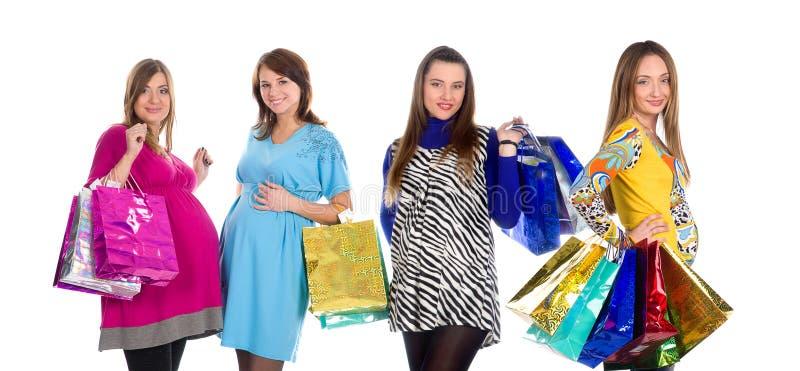 fyra gravida shoppingkvinnor royaltyfria bilder