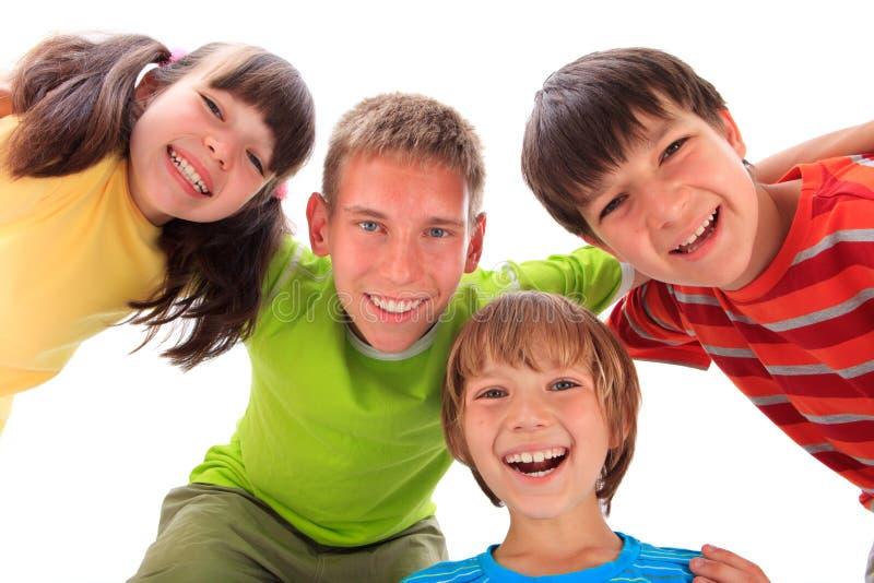fyra lyckliga ungar royaltyfria bilder