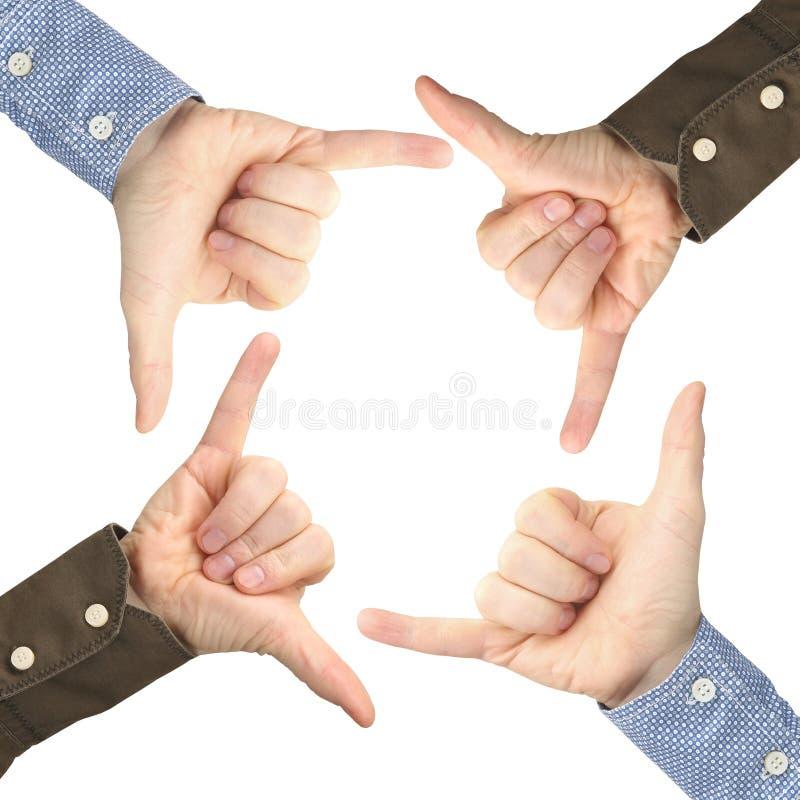 Fyra manliga händer med gester mitt emot de på en vit bakgrund fotografering för bildbyråer