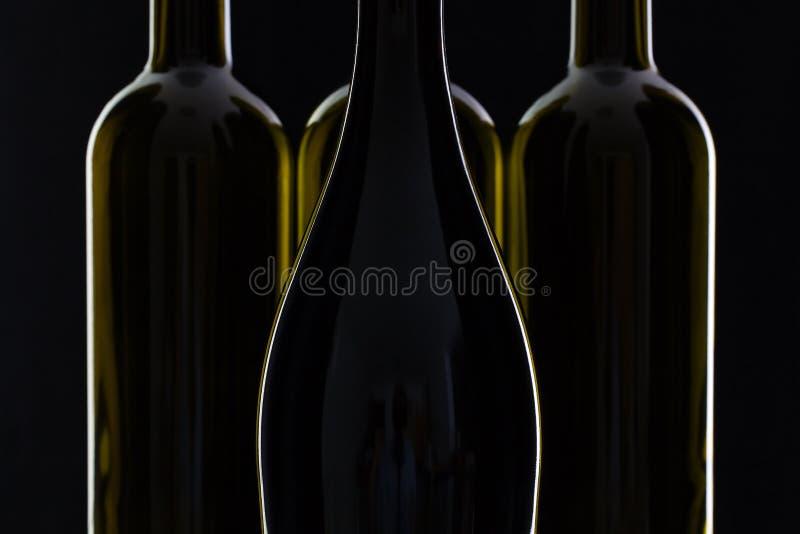 Fyra olika flaskor av vin arkivfoton