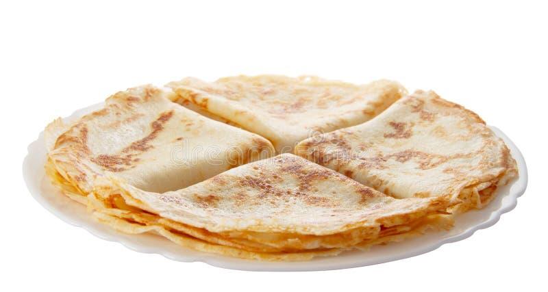 Fyra pannkakor på plätera arkivbilder
