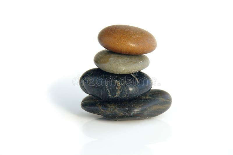 fyra pebbles arkivfoton
