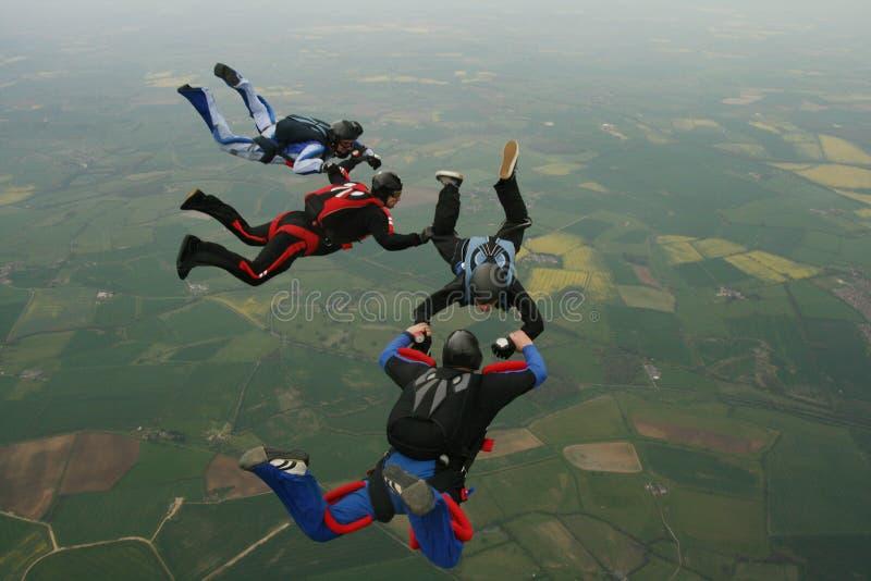 fyra skydivers fotografering för bildbyråer