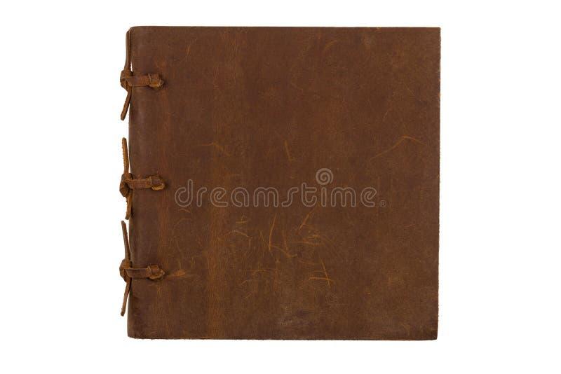 Fyrkantig anteckningsbok med läderbrunträkningen på vit bakgrund royaltyfri foto