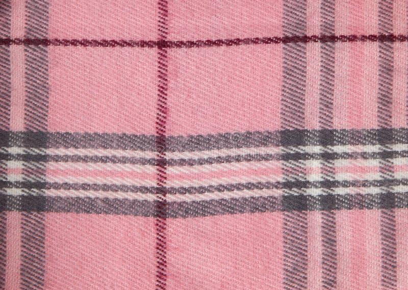Fyrkantig modelltygbakgrund Texturerar rosa och vitt bomullstyg Modellen för textiler cell Skjortapläd moderiktigt arkivfoton
