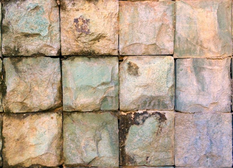 Fyrkantig stenbakgrund Texure arkivbilder
