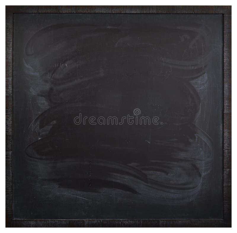 Fyrkantig tom svart tavla med fläckar från en våt trasa arkivfoton