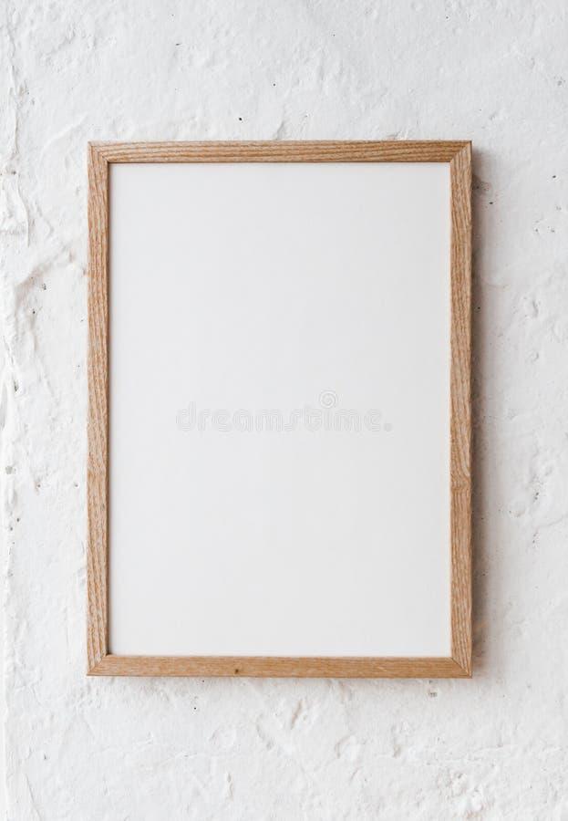 Fyrkantig vägg för vit för ramaffischåtlöje arkivfoton