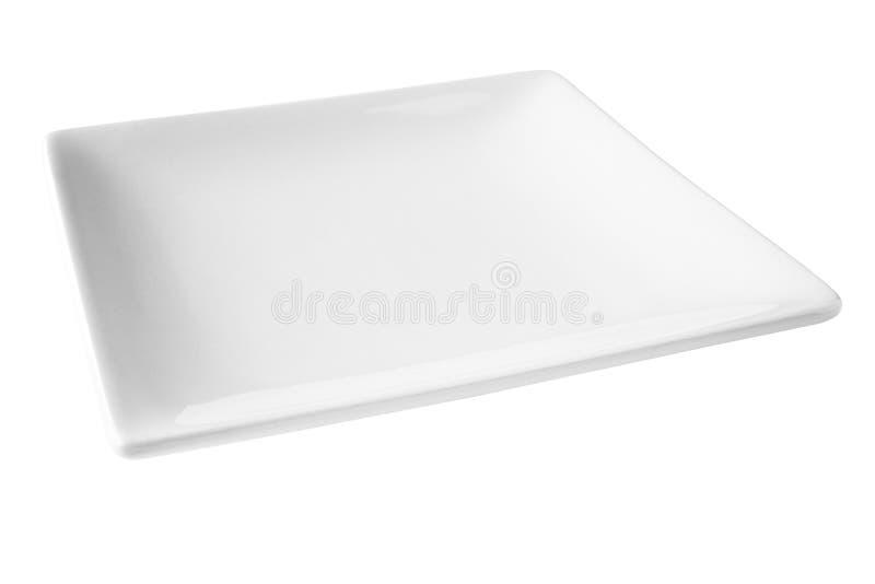 Fyrkantig vit platta som isoleras på White arkivbild
