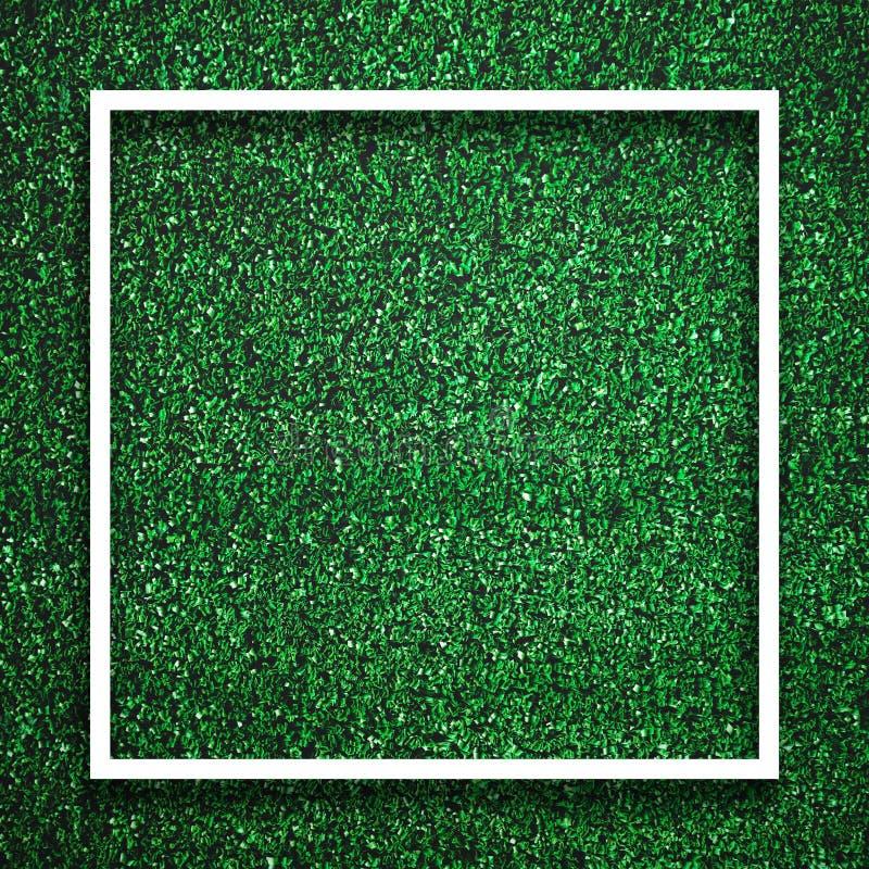 Fyrkantig vit ramkant för rektangel på grönt gräs med skuggabakgrund Begrepp för garneringbakgrundsbeståndsdel Kopiera utrymme f? royaltyfria foton