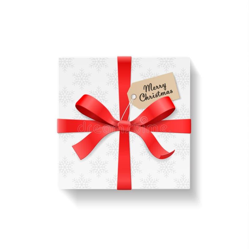 Fyrkantigt gåvaask, pilbågefnuren för röd färg och band med den kraft hängningetiketten Snöflingamodellpapper Text för glad jul stock illustrationer