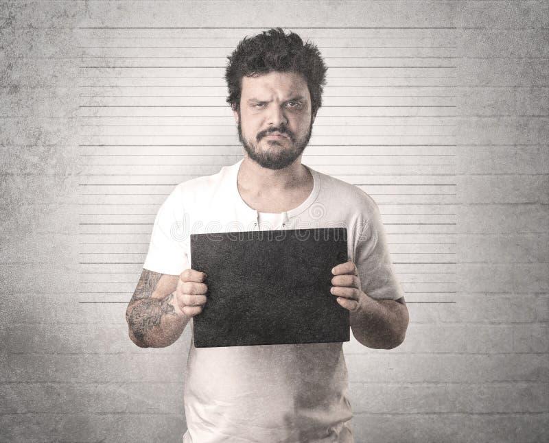 Gángster cogido en cárcel fotografía de archivo libre de regalías