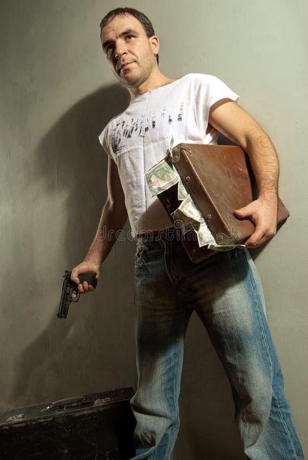 Gángster con el arma y el efectivo fotografía de archivo