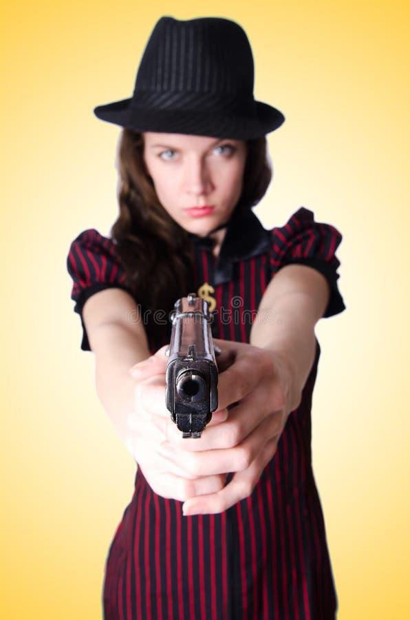 Gángster de la mujer con la arma de mano foto de archivo