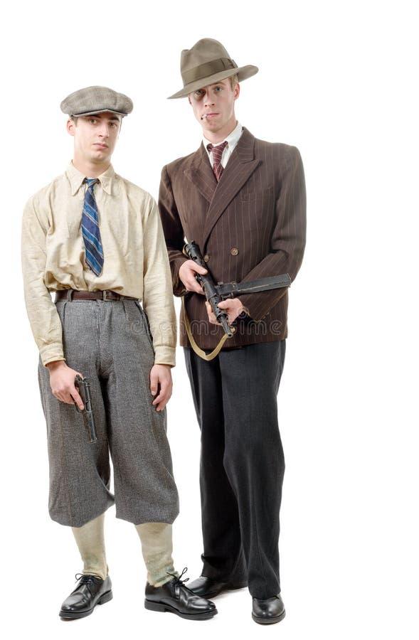 Gángster dos en ropa vintage, con los armas, fotos de archivo