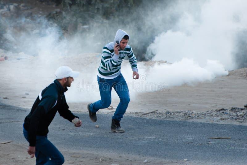 Gás de rasgo no protesto de Jerusalem fotografia de stock royalty free