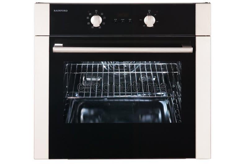 Gás incorporado Oven Isolated no fundo branco Front View do forno de aço inoxidável com uma gaveta de aquecimento da Grande-capac fotografia de stock royalty free
