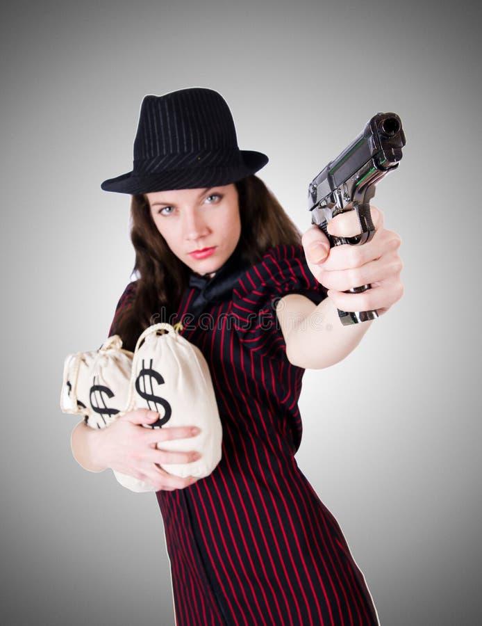 Gângster da mulher com o revólver no branco imagens de stock royalty free