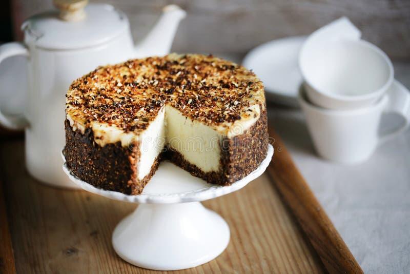 Gâteau au fromage entier de crème de grain avec du blé poussé, sain photo libre de droits