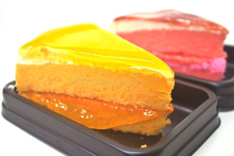 Gâteau au fromage orange de dessert avec le gâteau au fromage de fraise photo libre de droits