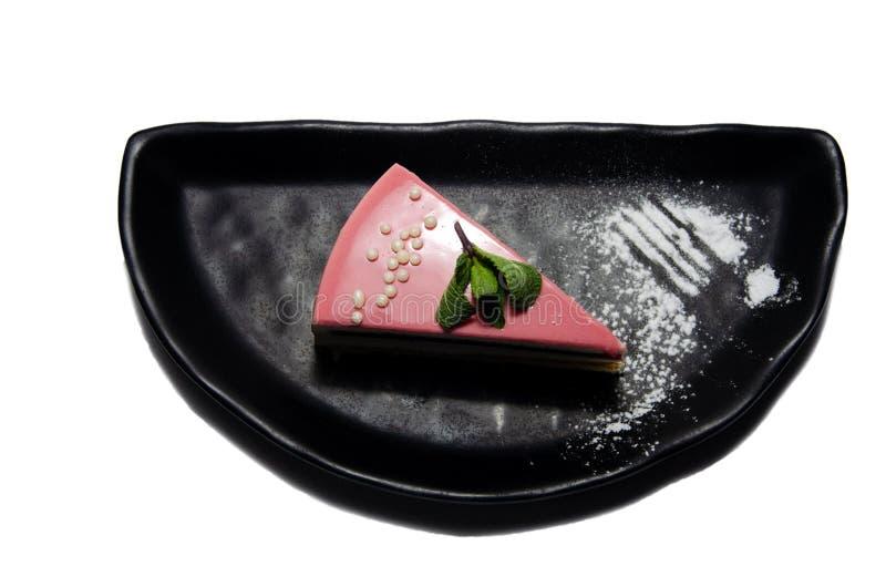 Gâteau avec le glaçage et la menthe de fraise photo stock