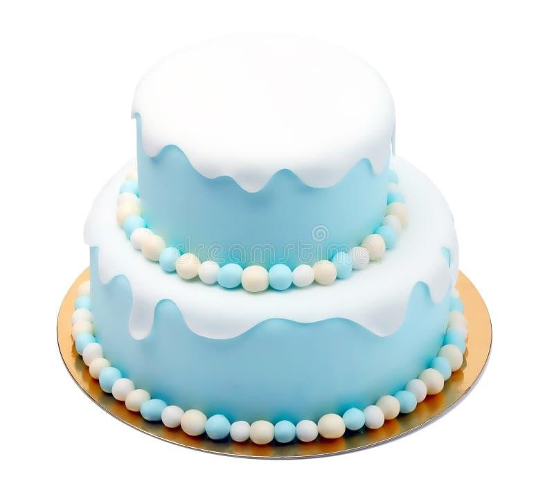 Gâteau bleu d'anniversaire avec de mini boules d'isolement sur le fond blanc image libre de droits