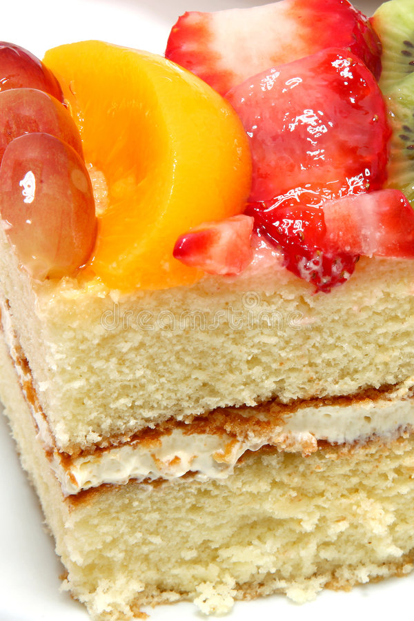 Gâteau complété par fruit glacé images libres de droits