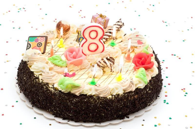 Gâteau d'anniversaire 8 ans photographie stock