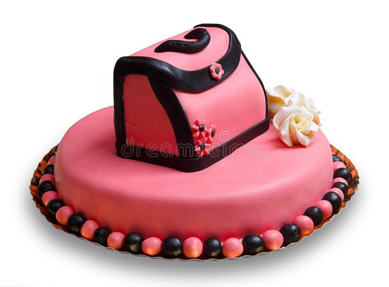 Gâteau d'anniversaire avec le givrage rose, sac à main décoré image libre de droits