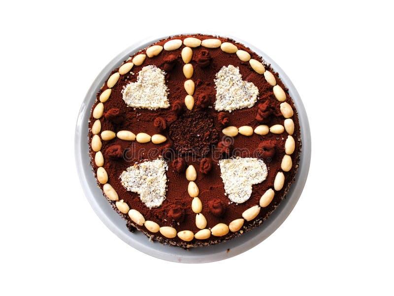 Gâteau de chocolat avec des coeurs de plat photographie stock libre de droits