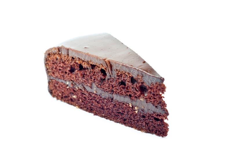 Gâteau de chocolat sur le fond blanc photo stock