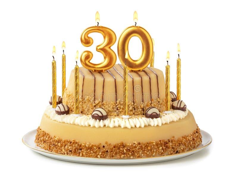 Gâteau de fête avec les bougies d'or - numéro 30 image libre de droits
