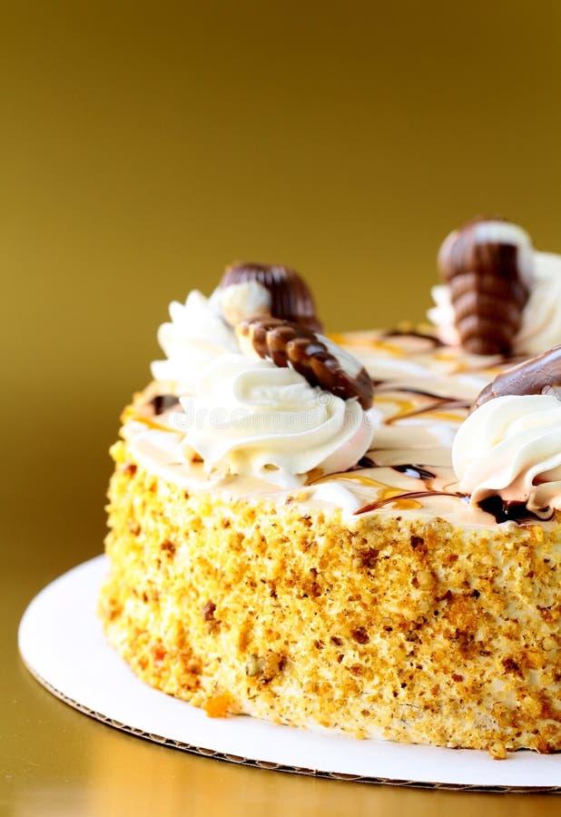 Gâteau de givrage crème blanc images stock