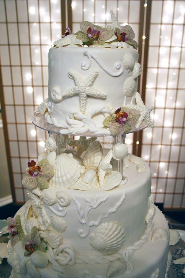 Gâteau de mariage d'interpréteur de commandes interactif de mer image libre de droits