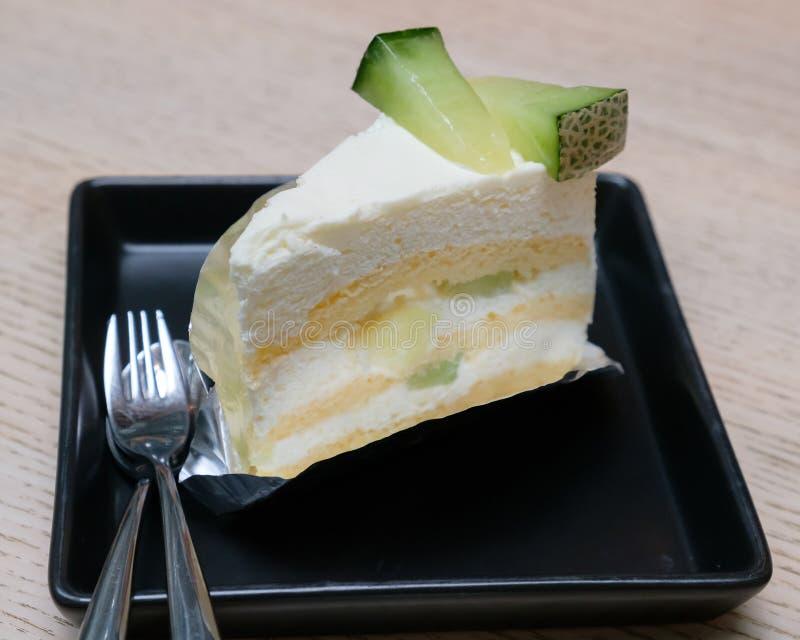 Gâteau de melon sur le plat image stock
